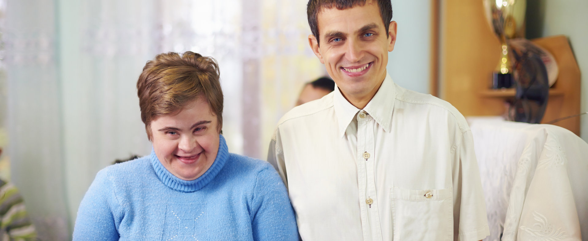 portrait of two happy friends with disability in rehabilitation center