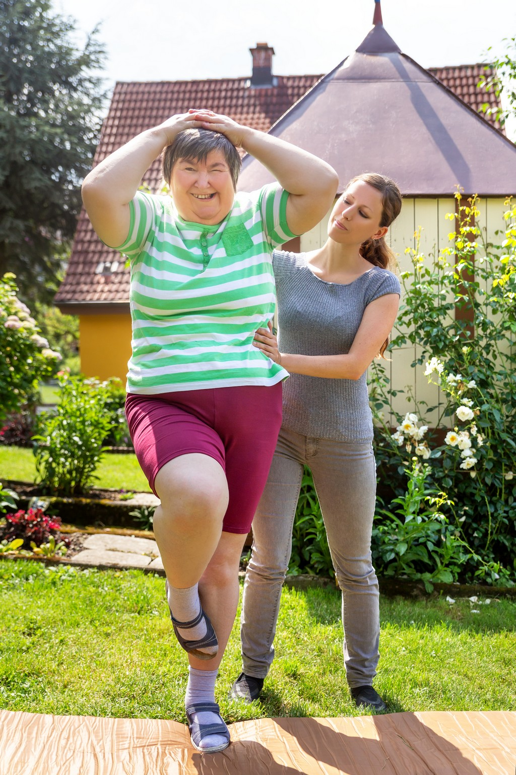 a caregiver helping her patient exercise