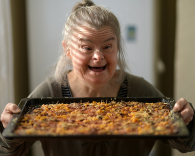 handicapped woman with home made pizza