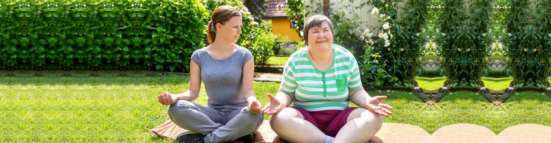 two women doing some yoga or relaxation exercises